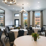 event space set up with round tables with chairs