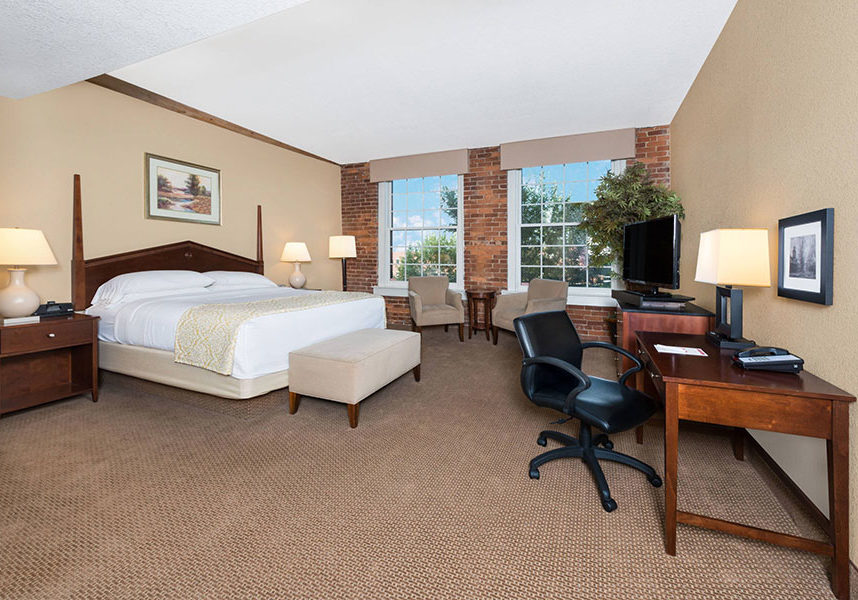 large guest room with one king bed